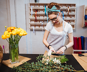 Woman making bouquets in a flower shop.