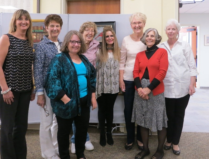 Ilona Blouin poses with the Watertown Art League Board of Directors before the award ceremony.