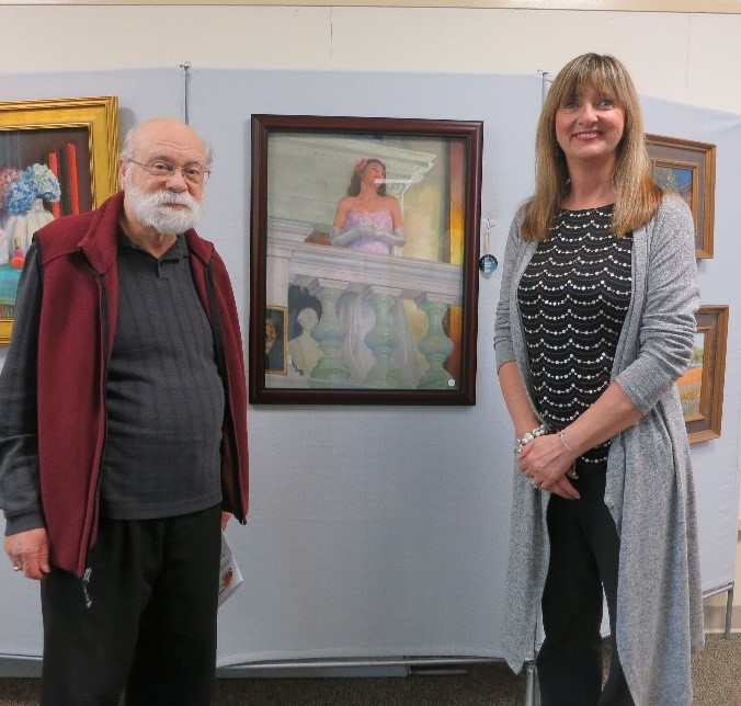 "Ralph Schwarz poses with Ilona Blouin next to his pastel drawing titled ""Budapest Opera Haz."""