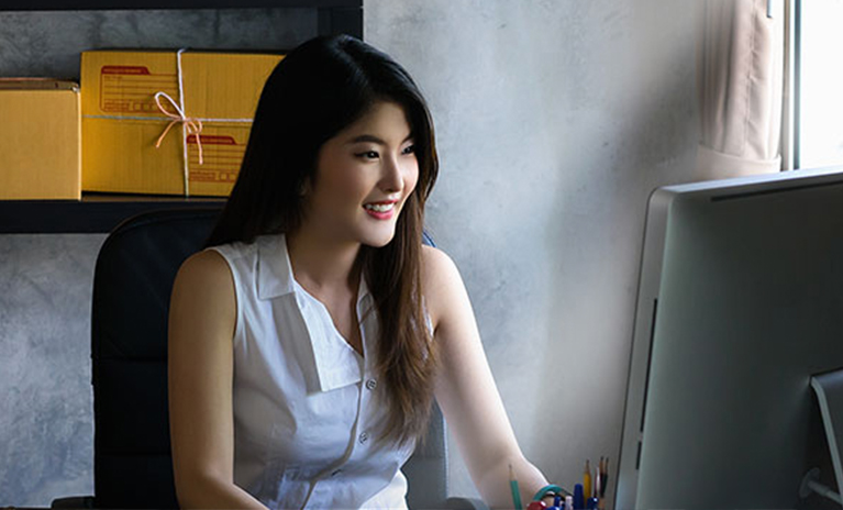 Woman working at her office computer
