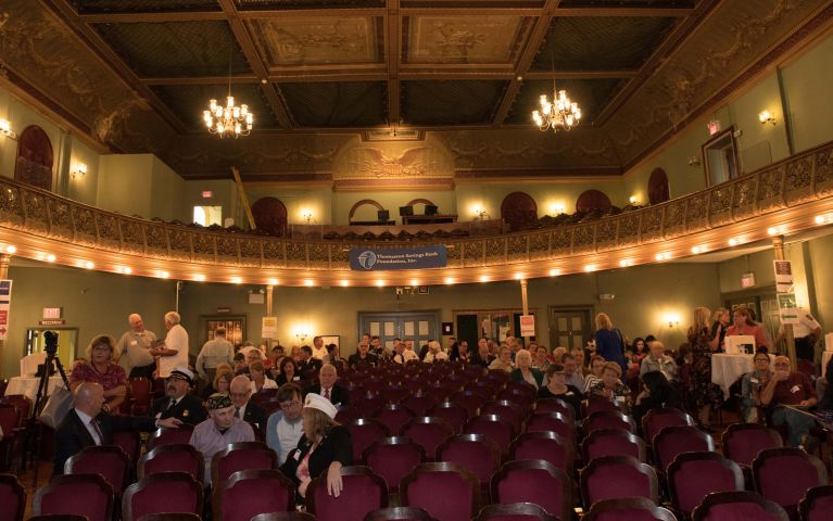Attendees fill in empty seats of theater where Thomaston Savings Bank 2019 Foundation Night is held.