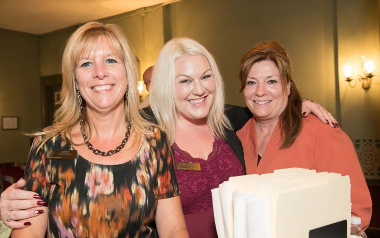 Three female TSB members and attendees smile and pose durint Foundation Night 2019.