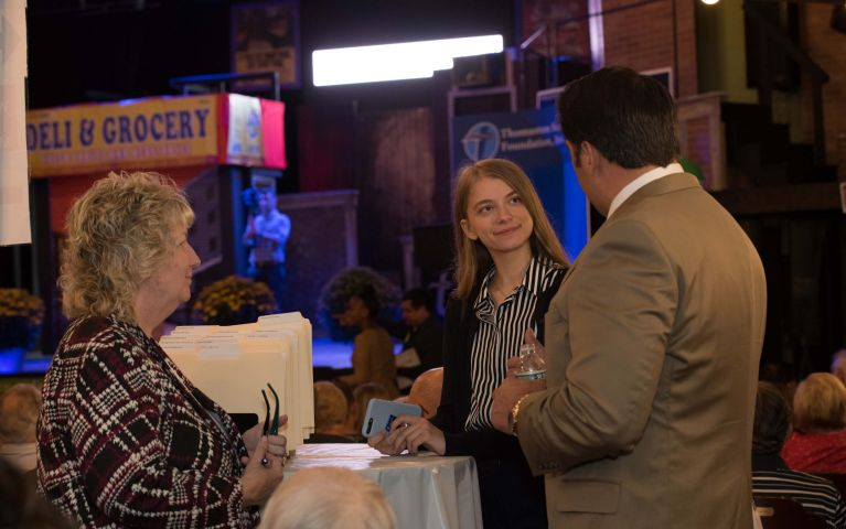 A female attendee engages another female attendee and a male Thomaston Savings Bank member in conversation at the 2019 Foundation Night event.