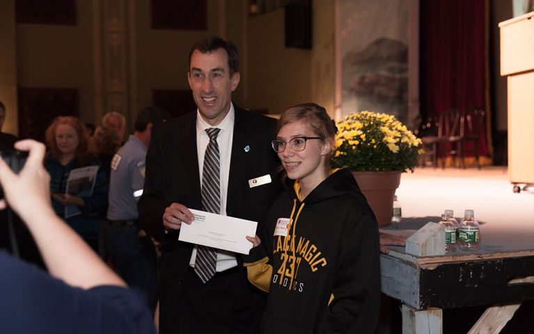 President of Thomaston Savings Bank, Stephen L. Lewis, smiles for a picture with a young woman at the 2017 TSB Foundation Night