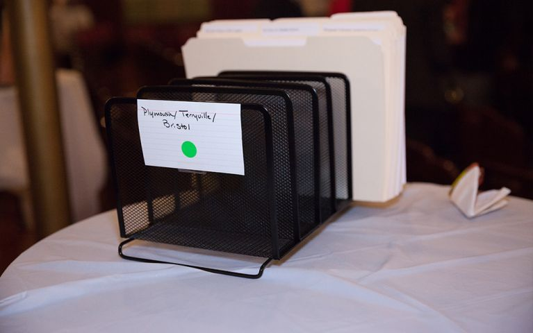 Picture of a filing folder rack labeled Plymouth/Terryville/Bristol at the 2017 TSB Foundation Night