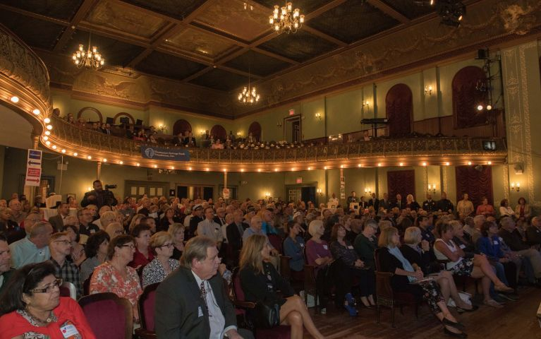 The theater that hosted Thomaston Savings Bank Foundation Night is filled with seated guests.