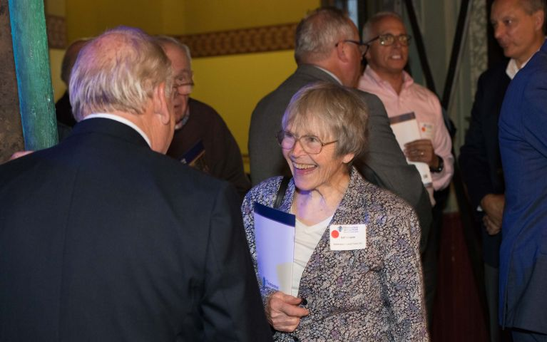 A TSB member is captured smiling mid-conversation with another guest during the TSB Foundation Night.