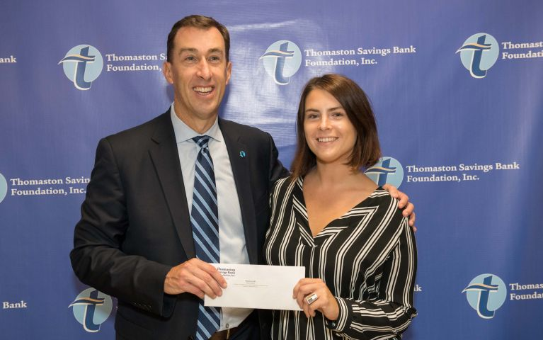 Stephen L. Lewis, Thomaston Savings Bank President presents check to 2019 Foundation Night female attendee.