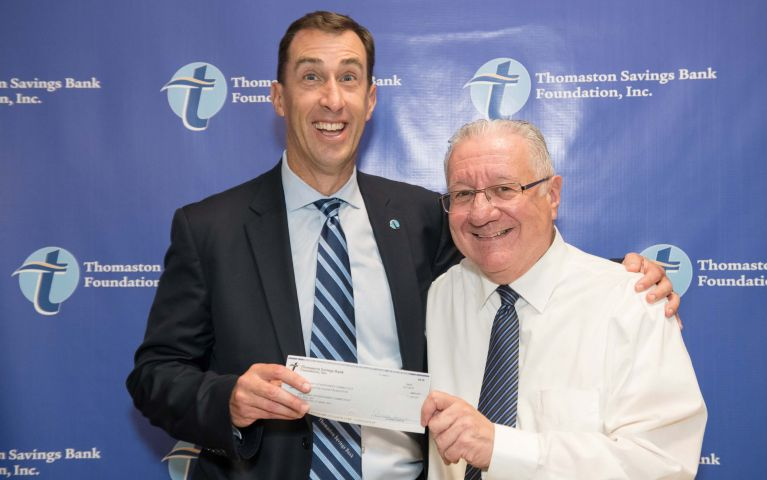 CEO and president of Thomaston Savings Bank, Stephen L. Lewis, is poses excitedly with a TSB community member as he presents him with a check for his dedication and community work at the 2019 Thomaston Savings Bank Foundation Night.