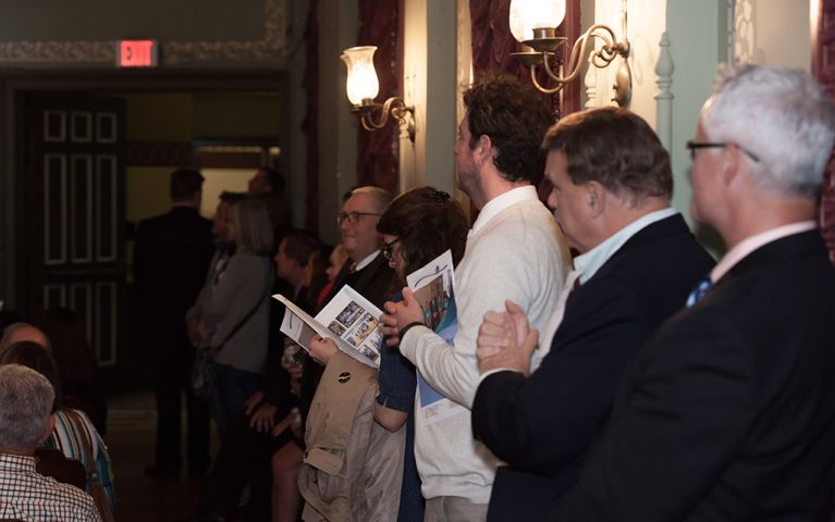 Attendees standing and lining the wall of the Thomaston Opera House for the 2017 Foundation Night