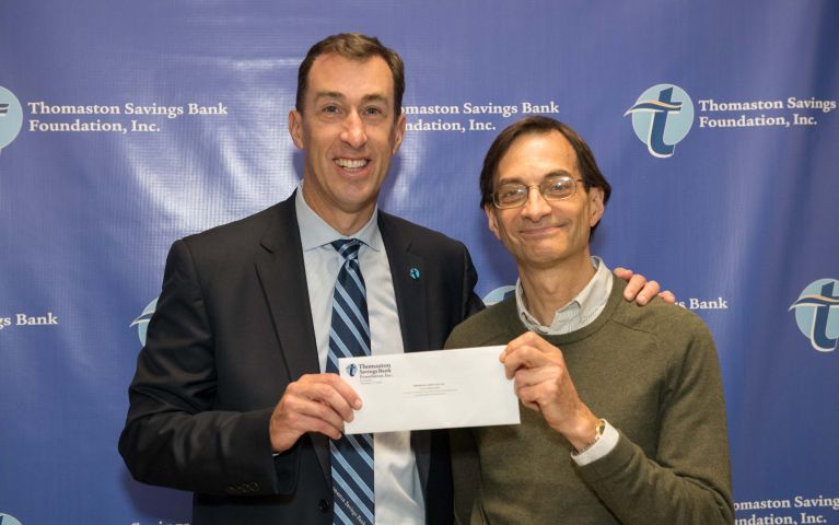 CEO and President of Thomaston Savings Bank, Stephen L. Lewis, hands a happy TSB customer an envelop at the 2019 Foundation Night.