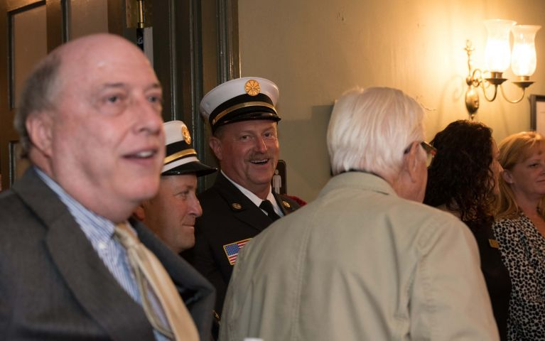 A male official is captured smiling during the 2019 Thomaston Savings Bank Foundation Night.