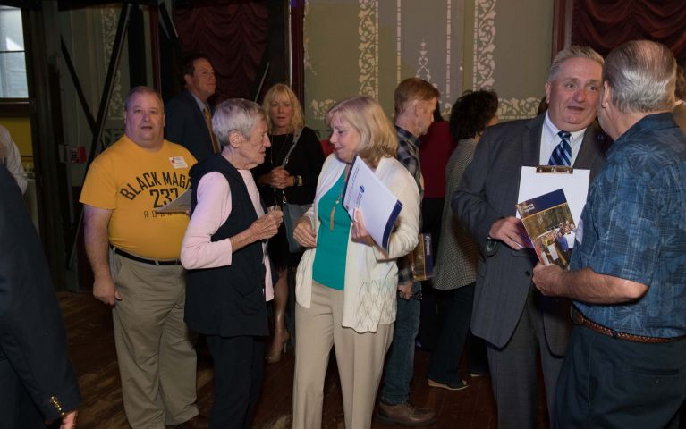 Event attendees shuffle through crowded theater during Thomaston Savings Bank 2019 Foundation Event.