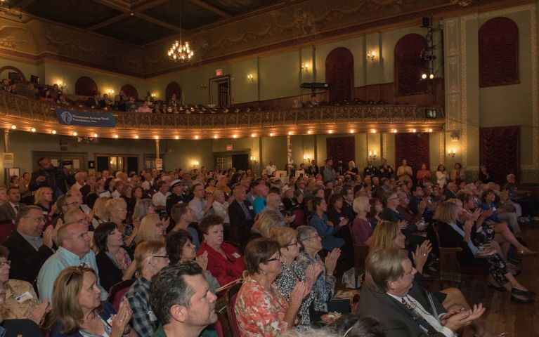 Thomaston Savings Bank guests clap while their seated in a full theater during TSBs event.