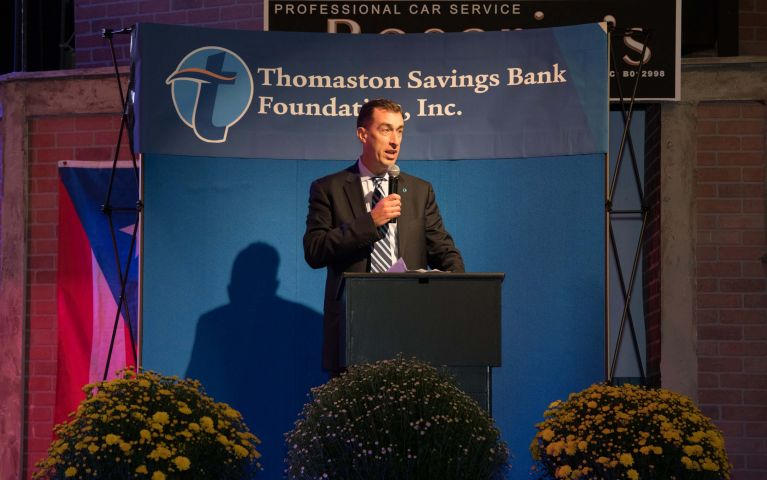 A closer photo is taken of CEO and president, Stephen L. Lewis on stage at the Thomaston Savings Bank 2019 Foundation Night.