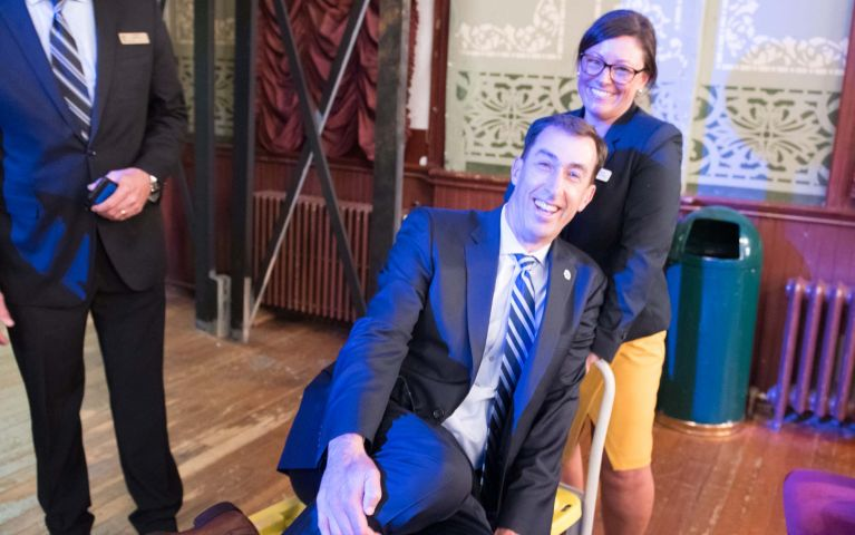 Thomaston Savings Bank President and CEO, Stephen L. Lewis being playfully pushed on a cart by other members at TSB's 2019 Foundation Night