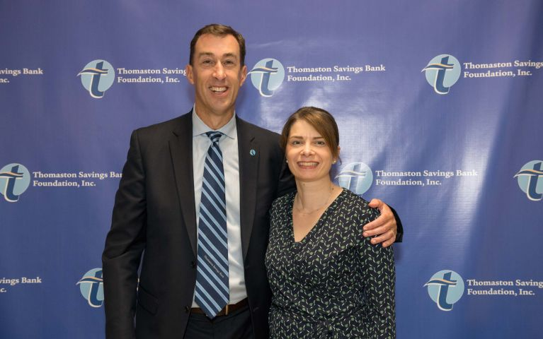 Stephen L. Lewis, CEO and president of Thomaston Savings Bank poses with another TSB member lovingly at the 2019 Foundation Night.