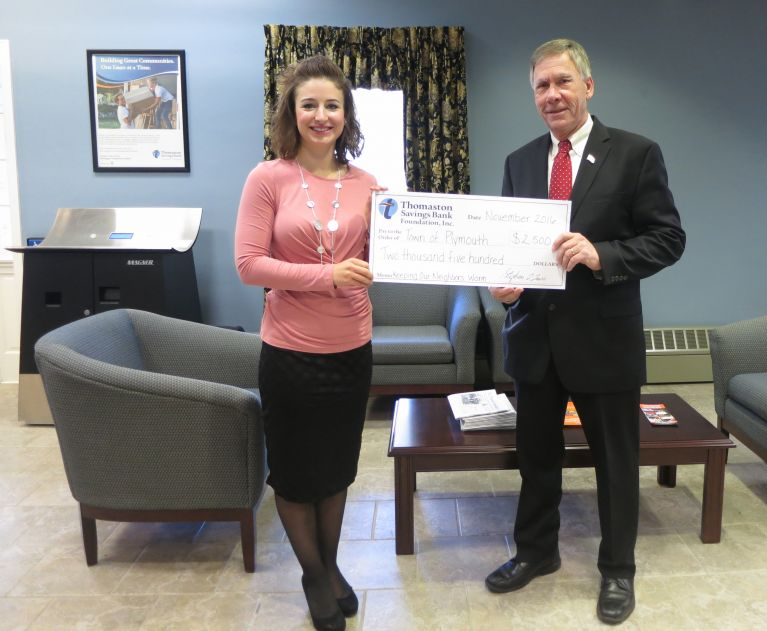 Assistant Secretary/Branch Manager Marissa McGee presents the Plymouth fuel bank donation to Mayor David V. Merchant.