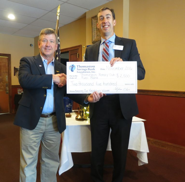 President and CEO Stephen Lewis presents the fuel bank donation check for the Thomaston Rotary Club to Michael Burr.