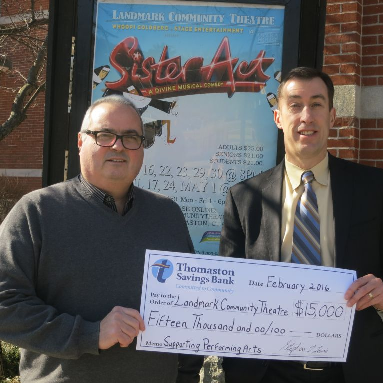 CEO of Thomaston Bank Stephen Lewis presents check to Jeff Dunn of the Landmark Community Theatre.