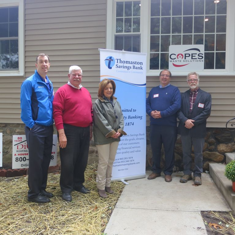 Members of Thomaston Savings Bank and Habitat for Humanity pose at the Habitat for Humanity of Greater Waterbury House Dedication.