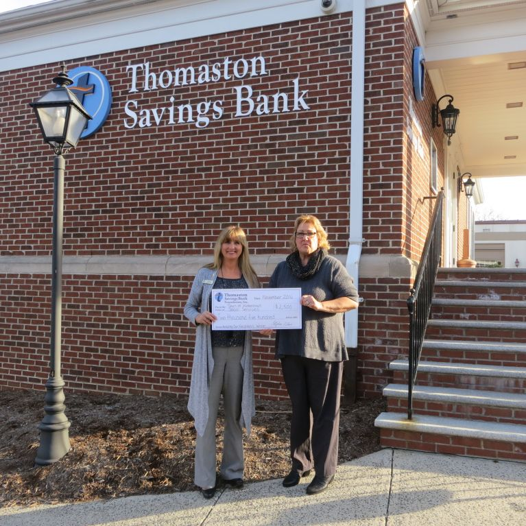 Branch manager Ilona Blouin presents the Watertown fuel bank donation check to Lisa Carew,  Director of Social Services for Watertown.