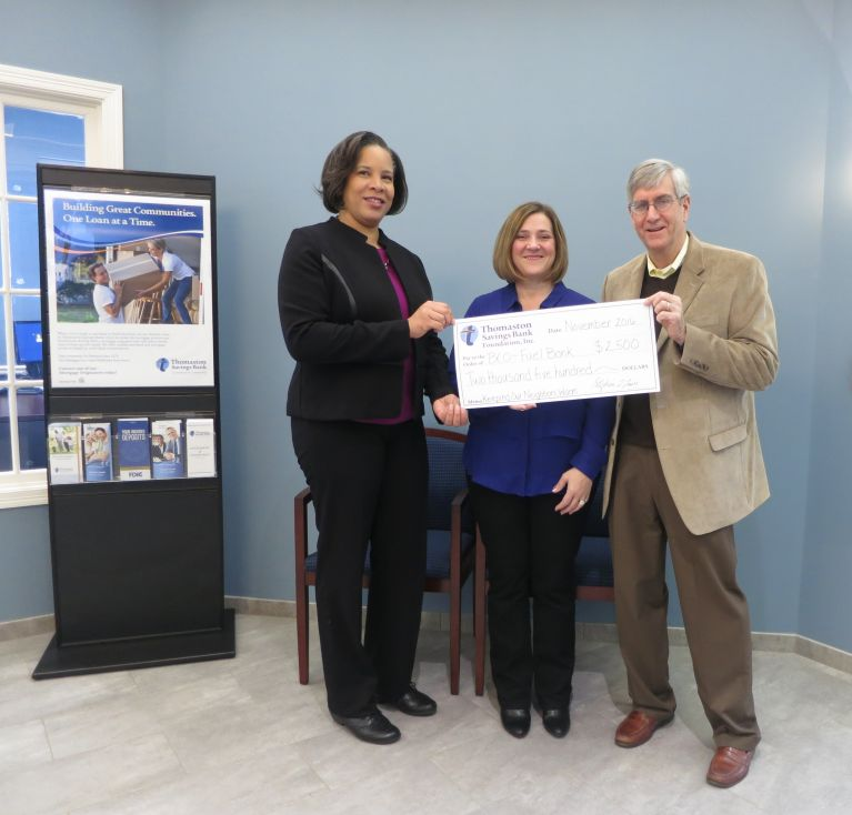 Executive Director Tom Morrow, Energy Coordinator of the Bristol Community Organization Shawn Anderson, and Branch Manager Phyllis Tucker hold the Bristol fuel bank donation check.